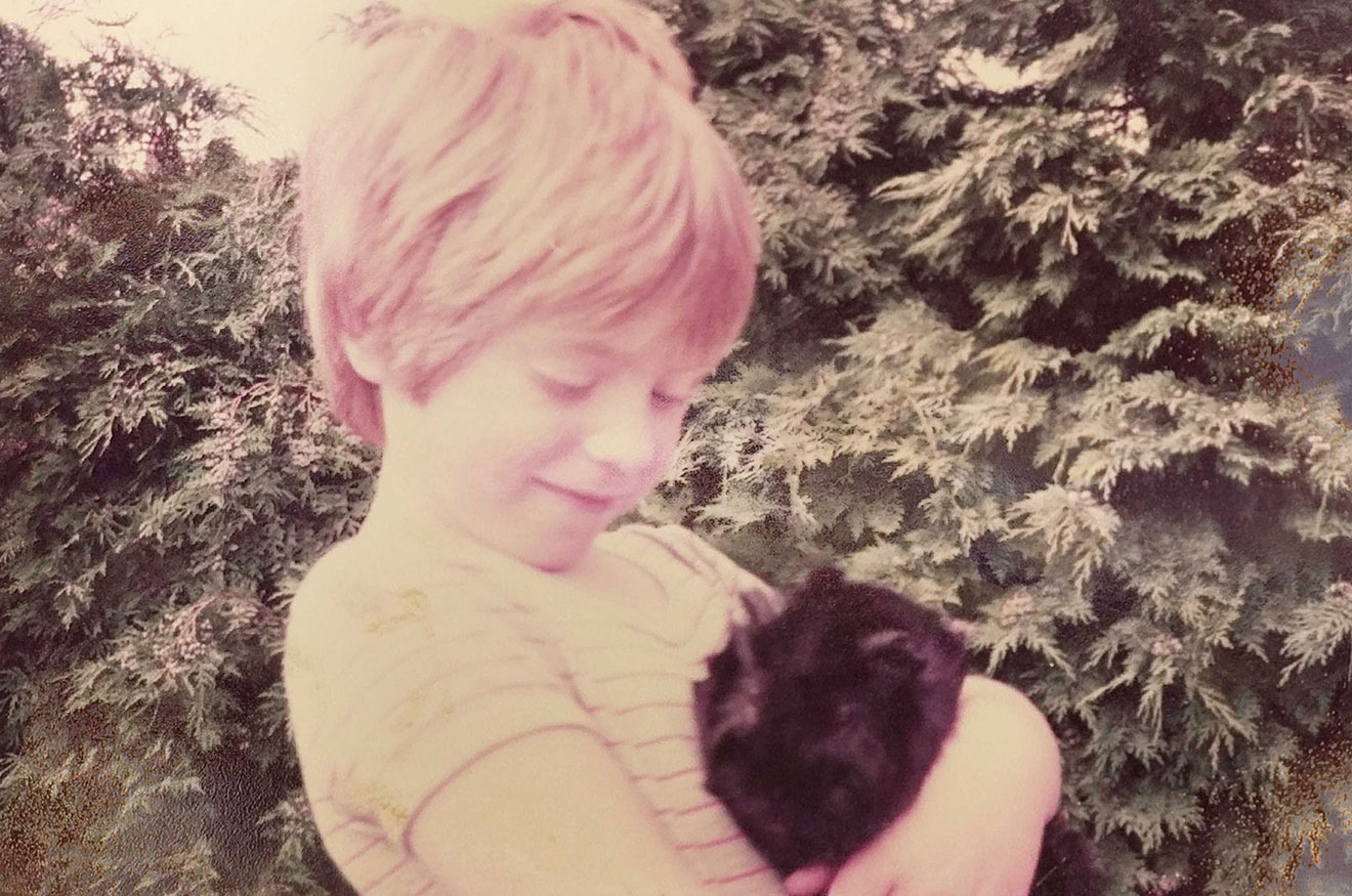 Photo of Remy Sharp as a young boy with his guinea pig
