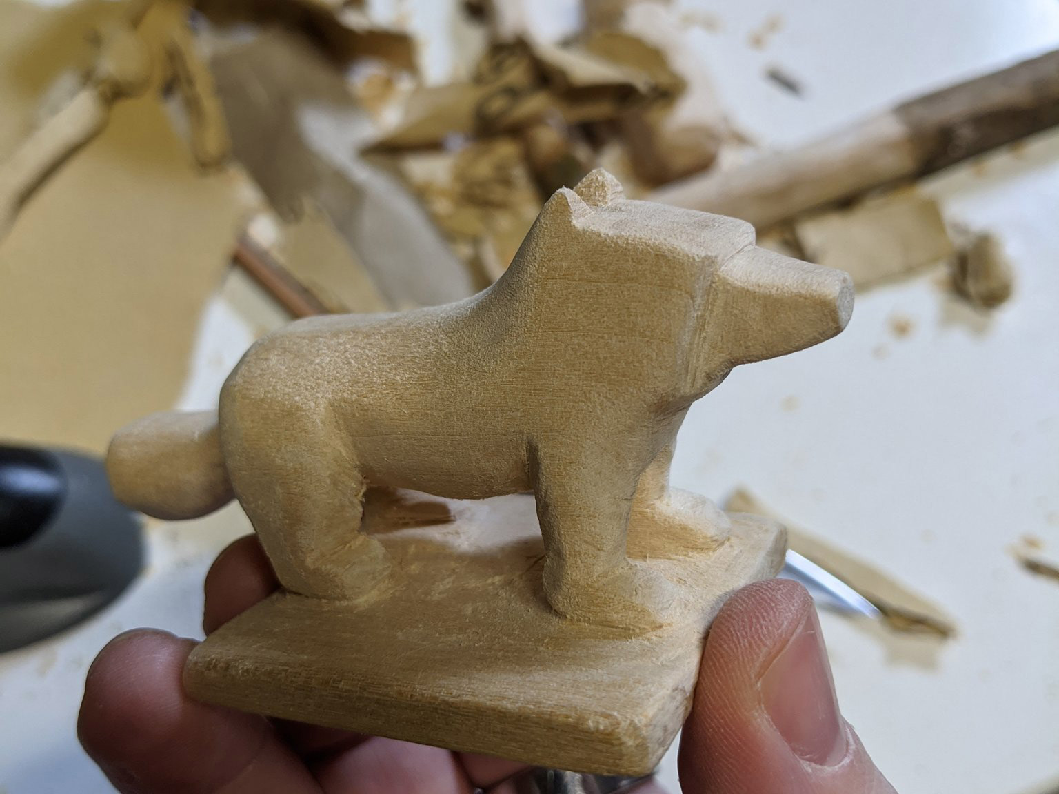Holding the dog to the side, fully formed and beginning to be smoothed out