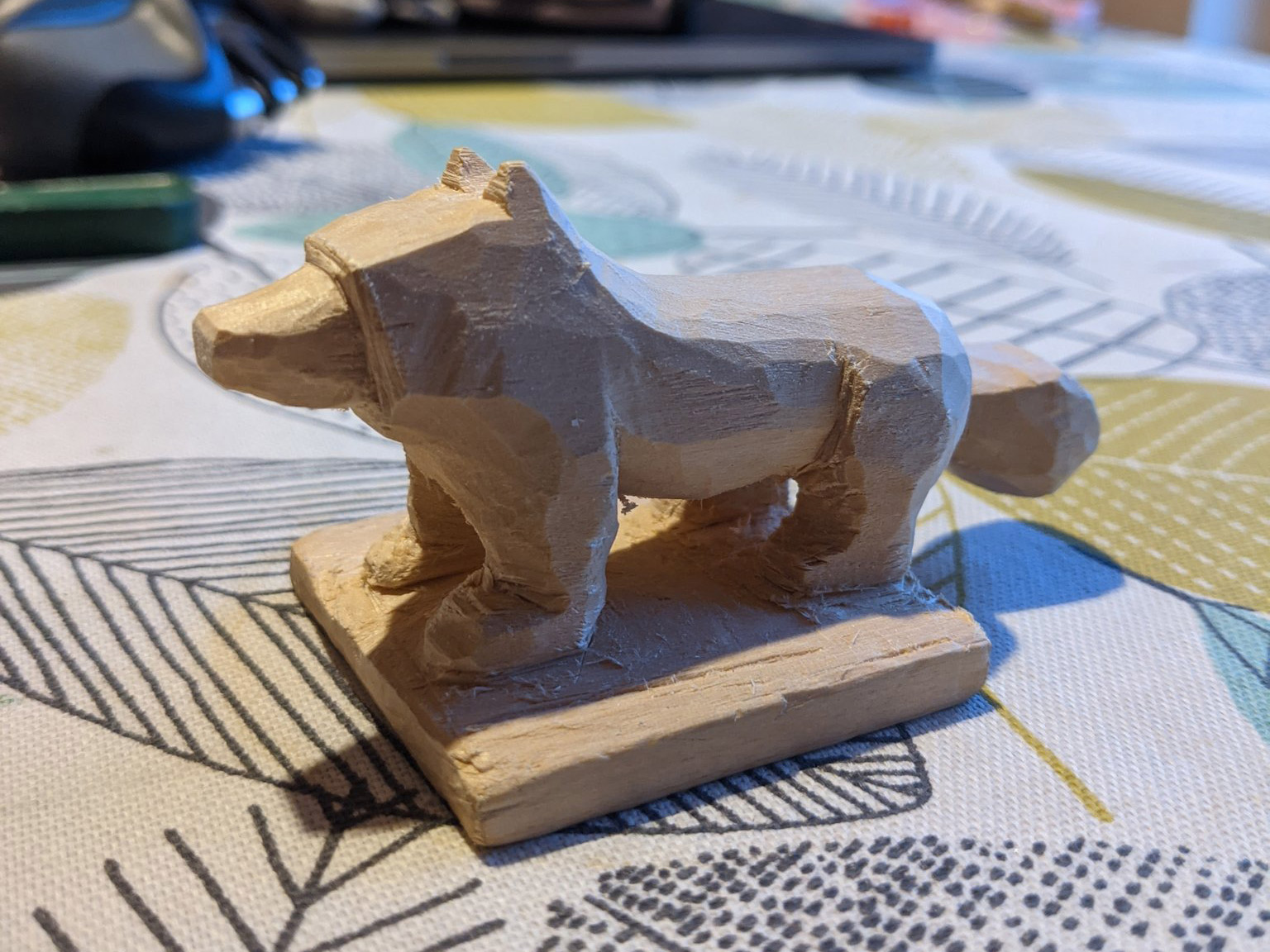 Side angle of the dog, mostly formed now, the snout, eats, legs, belly, back and tail are all clear, though proportions are a little off, it might be confused with a bear